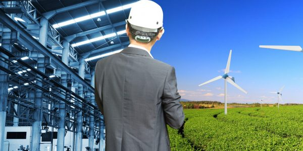 Industry of construction site and engineer working compare Wind turbine, agricultural landscape
