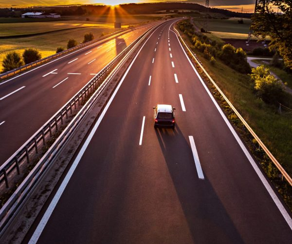 stretch of motorway in Germany by setting sun