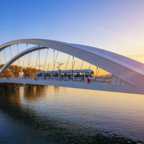 Tramway on the bridge at sunset, Lyon, France.